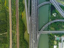 Aerial drone flight over evening road traffic. Two-level road junction. Top view. royalty free stock photo