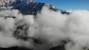 Aerial Drone Flight Over Mountain Range Through Clouds. Morning Mist Sun Light Flare Sunrise Beauty stock video footage
