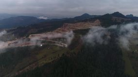 Aerial drone flight over quarry with big mountains on background. in Romania, Bicaz 4k 60fps stock footage