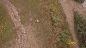 Aerial drone flight over small lake. camera rotation.  stock footage