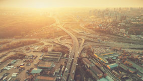 Aerial Drone Flight Photo of highway and overpass. With cars and trucks. Road Junction in the big city. Top view. Cityscape in sunset soft light. Instagram Stock Images