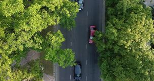 Aerial drone flight top down view of freeway busy city rush hour heavy traffic jam highway. Aerial view of the vehicular intersection,  traffic at peak hour stock video footage