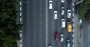 Aerial Drone Flight top down View of freeway busy city rush hour heavy traffic jam highway. Aerial view of the vehicular intersection,  traffic at peak hour stock footage