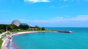 aerial drone footage of the city of Chicago planetarium and beach