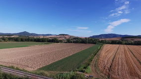 Aerial drone footage - flying over fields in Italy. Aerial shot in Tuscany, Italy - Drone footage stock video footage