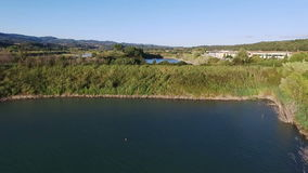 Aerial drone footage - flying over a lake in Italy stock video footage