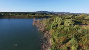 Aerial drone footage - flying over a lake in Italy. Aerial shot in Tuscany, Italy - Drone footage stock video
