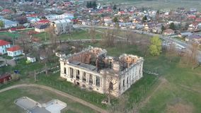 Ruins of Cantacuzino Palace in Floresti, Romania. Aerial drone footage , flying over the ruins of the Cantacuzino Palace in Floresti , Romania, at sunset stock video footage