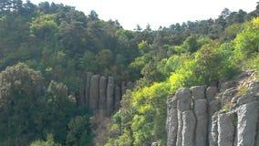 Aerial drone footage from old basalt column in Hungary, mountain Saint George. Near the lake Balaton stock footage