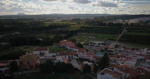 Aerial flight over small Spanish village. Aerial drone footage over small Spanish village with cloudy and overcast sky and smooth forward movement over stock video