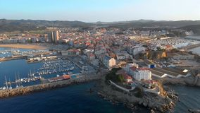 Aerial drone footage from small town Palamos of Spain, in Costa Brava