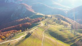 Aerial Drone Footage View: Flight over autumn landscape, hills and colorful forest