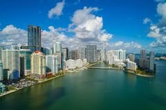 Aerial drone image Brickell city on the bay blue sky and puffy clouds. Aerial image of Brickell Miami 2017 shot with a drone over Biscayne Bay beautiful puffy Royalty Free Stock Photography