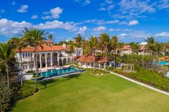 Drone photo Boynton Beach FL USA. Aerial drone image of a luxury home in Boynton Beach FL with palm trees and pool Stock Images