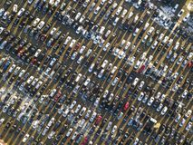 Aerial drone image of many cars parked on parking lot, top view.  stock photos