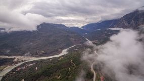 Aerial drone image of a river crossing through mountains stock photography