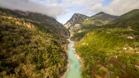 Aerial drone image of a river crossing through mountains stock image