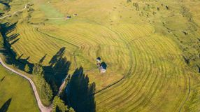 Aerial drone landscape of the meadows at high altitudes, forming soft hills. Dolomites, Alta Badia, Sud Tirol, Italy. Summer season royalty free stock image