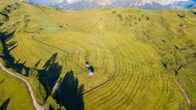 Aerial drone landscape of the meadows at high altitudes, forming soft hills. Dolomites, Alta Badia, Sud Tirol, Italy. Summer season stock image