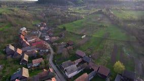 Aerial drone moving above village. Manastireni, Transylvania, Romania stock footage