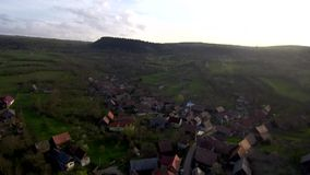 Aerial drone moving above village. Transylvania, Romania stock video footage