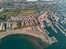 Aerial drone panorama Almerimar townscape, province of Almeria, Andalucia, Spain. Aerial drone point view panorama of Almerimar townscape, greenhouses, moored stock images