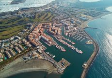 Aerial drone panorama Almerimar townscape, province of Almeria, Andalucia, Spain. Aerial drone point view panorama of Almerimar townscape, greenhouses, moored royalty free stock photos
