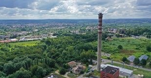 Free Aerial Drone Perspective View On High Concrete Chimney In Heating Plant Close To The City Stock Images - 161621714