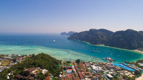 Aerial drone photo of Andaman sea and limestones, shot done behind iconic tropical beach and resorts of Phi Phi island Stock Images