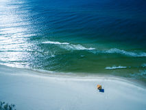 Aerial Drone Photo - Beautiful ocean and beaches of Gulf Shores / Fort Morgan, Alabama. Mesmerizing drone photograph of a solitary umbrella on the pristine white royalty free stock photos