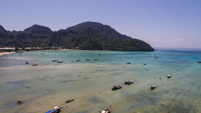 Aerial drone photo of boats on the sea during ebb tide on iconic tropical beach  of Phi Phi island Royalty Free Stock Image