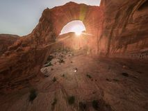 Aerial drone photo - Bride and groom under the Corona Arch at sunset stock photography