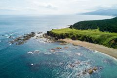 Aerial drone photo of cape Velikan near by cape Prichiy, Sakhalin island, Russia Sahalin. royalty free stock images