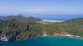 Aerial drone photo of coastline behind iconic tropical beach of Phi Phi island Stock Photos