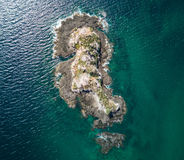 Aerial Drone Photo - Deserted island in the Pacific Ocean off the coast of Costa Rica. A stunning drone photograph showing a deserted island in the Pacific Ocean Royalty Free Stock Photos
