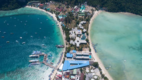 Aerial drone photo of iconic tropical beach and resorts of Phi Phi island Stock Photos
