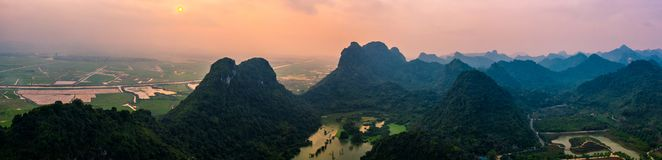 Aerial drone photo - Mountains and lakes of northern Vietnam at sunset. stock photography
