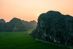 Aerial drone photo - Mountains and rice fields of North Vietnam at sunset. royalty free stock photo