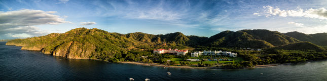 Aerial Drone Photo - Resort hotels along the Pacific coast of Costa Rica, surrounded by rugged mountains. Resort hotels along the Pacific Ocean coast of Costa stock image