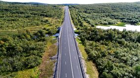Aerial drone photo of rural bridge in the forest stock photo