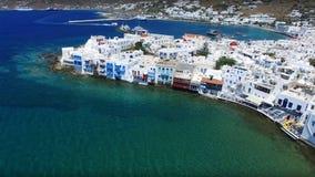 Aerial drone photo of Santorini island, Cyclades, Greece. Aerial drone photo of Mykonos island, on a summer morning, Cyclades, Greece Stock Photo
