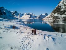 Women posing in the mountains of the Lofoten Islands. Reine, Norway stock photography