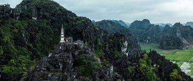 Aerial drone photo - Woman next to a shrine atop a mountain in northern Vietnam.  Hang Mua royalty free stock images