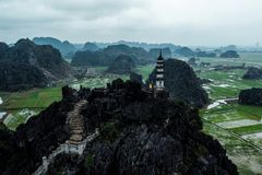 Aerial drone photo - Woman next to a shrine atop a mountain in northern Vietnam.  Hang Mua stock photography