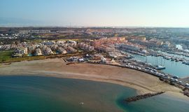 Aerial drone photography Almerimar townscape. Almeria, Spain. Aerial drone point view photography Almerimar townscape, empty beach sandy coastline, nautical stock image