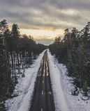 Aerial Drone Photography of a Road Between Woods in Winter - vin royalty free stock photos