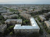 Aerial drone shot of downtown with house with new silver roof in the front. Summer day in Magnitogorsk, Russia.  stock photography