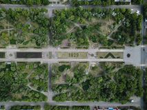 Aerial drone shot of green park in city downtown at sunny day royalty free stock images