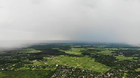 Aerial drone shot of heavy rainfall approaching the village suburban stock video footage