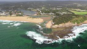 Aerial drone shot of an ocean rock pool near Sydney, Australia. Aerial drone shot of an ocean rock pool on the beach with swimmers near Sydney, NSW, Australia stock video